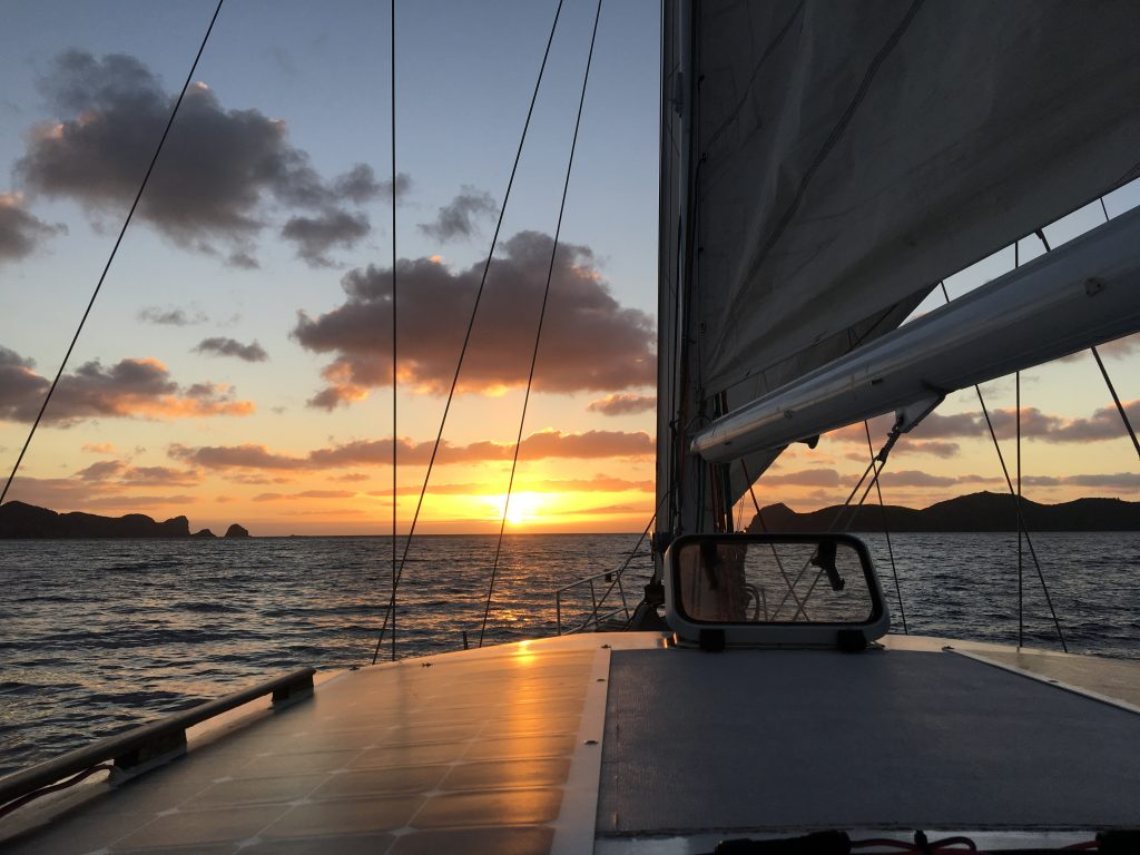 Sailing into the sunset out of Port Fitzroy, Great Barrier Island